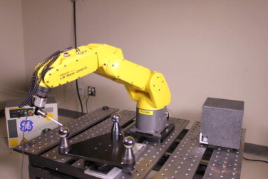 Non-kinematic calibration of a six-axis serial robot using planar