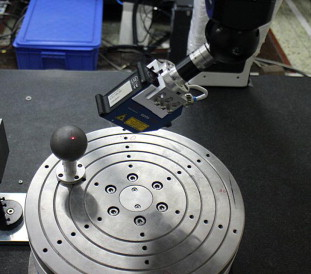 Calibration of laser beam direction for optical coordinate measuring