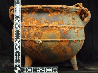 A Santería/Palo Mayombe ritual cauldron containing a human